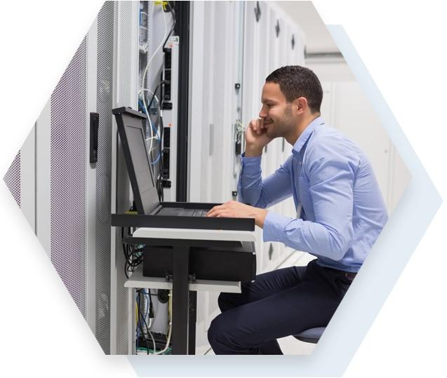 Man Working in Computer Server Room